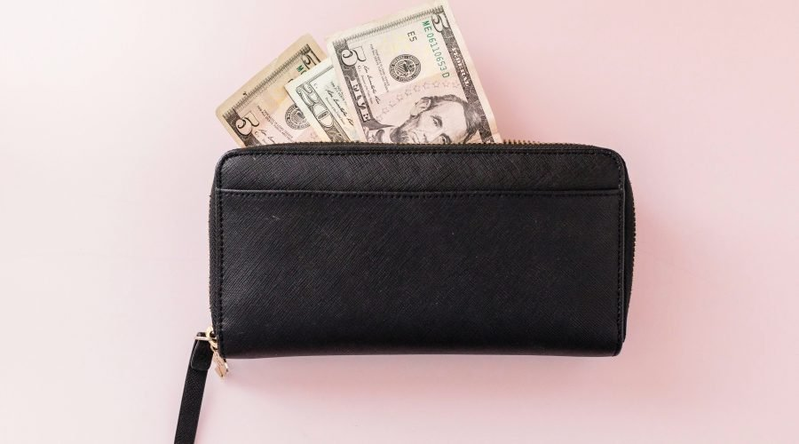 black wallet with money