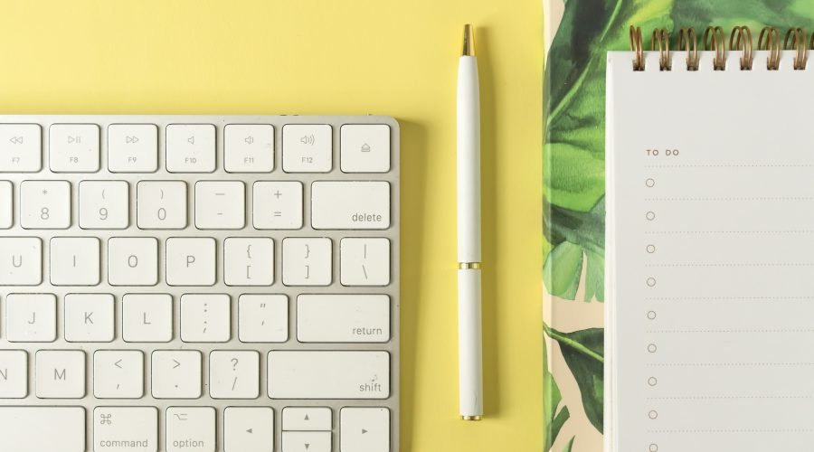 keyboard with pen and notepad