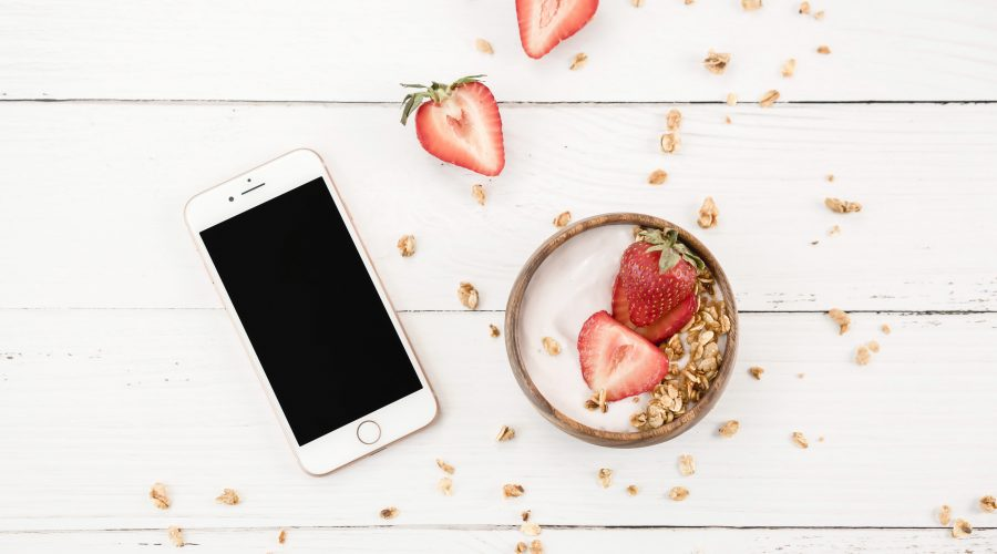 iphone and bowl with strawberries